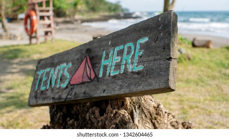 Sign on a wood for campers where tents should be set up.