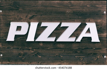 sign on wooden table pizza