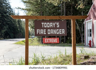 Sign outside a fire station with Today's Fire Danger Extreme in summer.