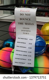 Sign outside a gift shop in Grange over Sands asking people to not bounce the balls