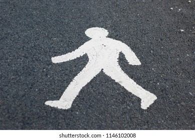 Sign of pedestrians on the ground