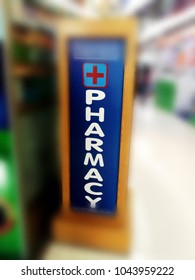 Sign of Phamacy Shop with blur or defocus image background