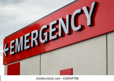Sign pointing to a hospital emergency room in Melbourne, Australia.