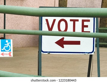 Sign pointing to a polling station