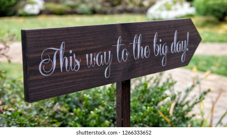 Sign Pointing to wedding spot