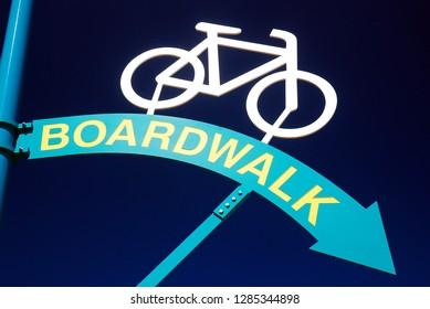A sign points to the bike path on the boardwalk