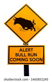 A sign pole with a running bull and the stock market concept message: Alert Bull run coming soon. Isolated against white.