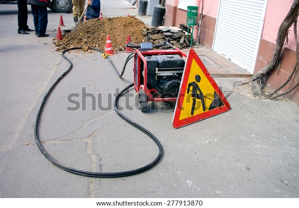 Sign Portable Generator On Road Construction Stock Photo