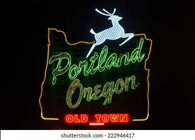 Sign in Portland, Oregon with jumping deer and image of oregon's borders