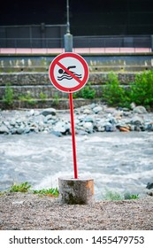 sign prohibiting swimming in the river
