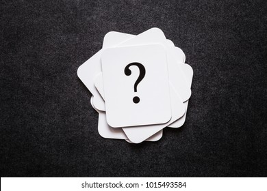 Sign of question cards on the black background. Solution search concept.