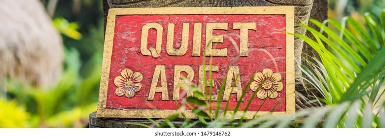 A sign QUIET AREA in a quiet corner of the garden BANNER, LONG FORMAT
