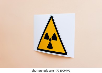 sign of radiation hazard hanging on the wall