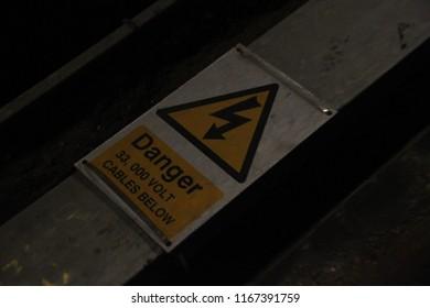 Sign reading - Danger 33,000 volt cables below