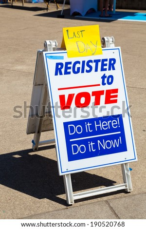 Sign reading Last Day Register to Vote trying to get voters to signup for political voting registration.