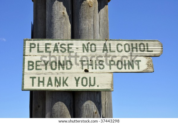 """sign reading """"no alcohol beyond this point thank you"""""""