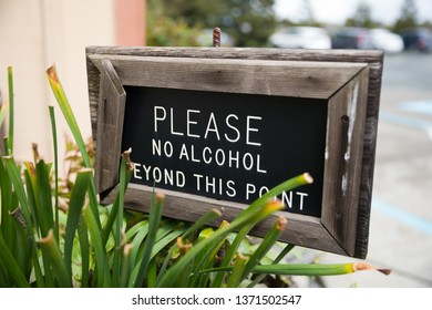 Sign reads please no alcohol beyond this point at a picnic area of a local winery in Sonoma California.