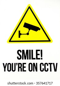 Sign reads: Smile you are on CCTV. Security concept. Isolated on white. No people. Copy space