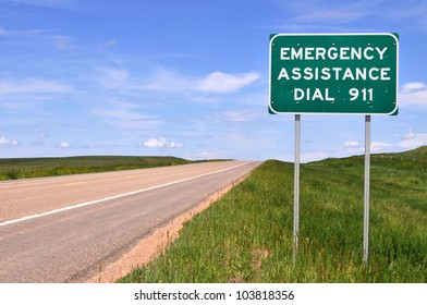Sign reminding motorists of the emergency number 911.