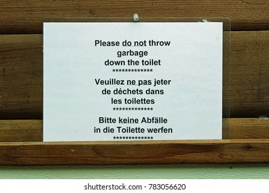 Sign requesting not to throw garbage down the toilet.