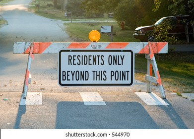Sign: RESIDENTS ONLY BEYOND THIS POINT