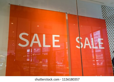 sign of sale on shopping mall window