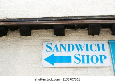 A sign for a sandwich shop in and english town