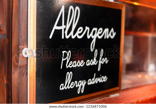 """Sign saying """"Allergens, Please ask for allergy advice' at a market stall"""