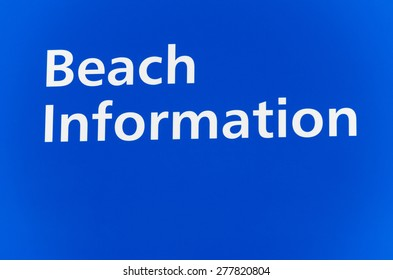 A sign saying beach information.