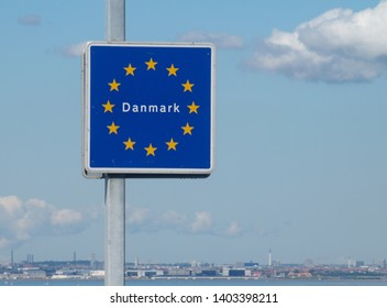 "sign saying ""Danmark"" (Denmark) on the Öresund bridge. Kopenhagen in the background"