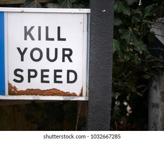 Sign saying 'kill your speed' in rural UK, showing concept of traffic calming, road accident, dangerous driving, crash