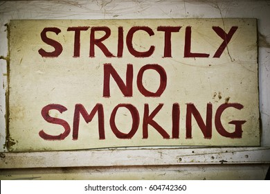 A sign saying Strictly No Smoking on the wall of a furniture maker;s workshop