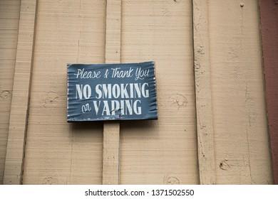 Sign says no smoking and no vaping at an outdoor winery in Sonoma California.