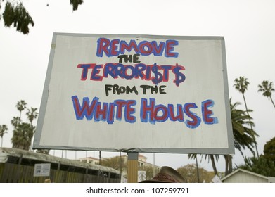 "A sign says ""Remove the terrorists from the White House"" at an anti-Iraq War protest march in Santa Barbara, California on March 17, 2007"