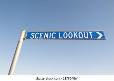 A sign to a scenic lookout or a point of interest, with blue sky as background and copy space.