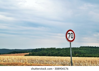 Sign of seventy in blue cloudy sky