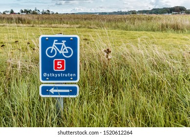 Sign showing the bicycle path along the east coast of Denmark, Holl, Denmark, September 3, 2019