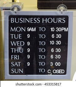 Sign showing business opening hours