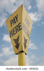 A sign showing the position of a pay-point isolated with path.
