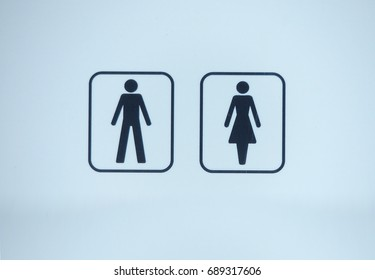 A sign showing that a toilet or WC may be used by men and women