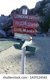 Sign showing various destinations in Preveli beach, Crete island, Greece