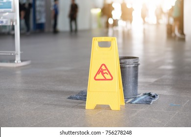 Sign showing warning of caution wet floor at airport