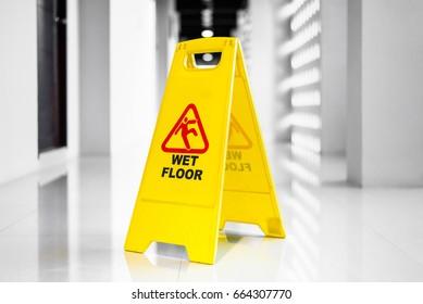 Sign showing warning of  wet floor on wet  floor