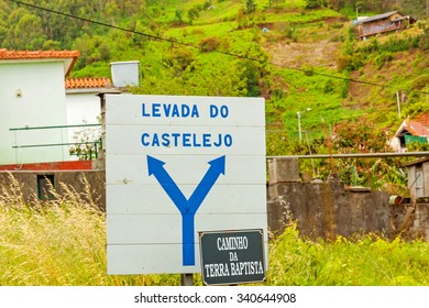 Sign showing the way to the hiking path called Levada do Castelejo, a path for hikers along the famous irrigation channels (levadas) of Madeira island.