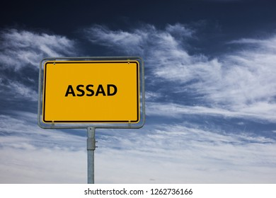 sign showing the word ASSAD, in the background is a stormy blue sky