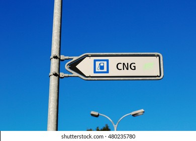Sign shows direction gas station with CNG.