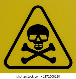 Sign with a skull and bones warning of deadly danger.