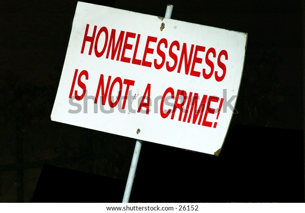 A sign spotted on a beach front balcony on Venice Beach California. An area where homelessness has reached epic proportions and is surrounded by opulence.