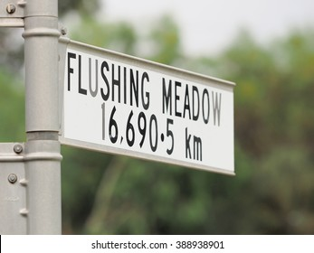 Sign stating distance from sign to Flushing Meadow in New York, one of the 4 Tennis Grand Slam locations, Melbourne 2016