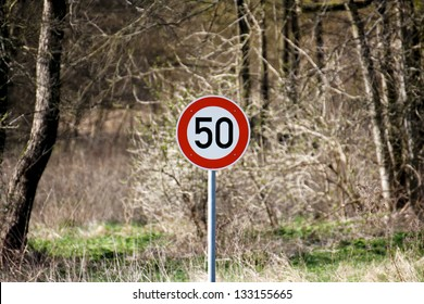 Sign stating speed limit of 50 km/h in the German countryside near Berlin.